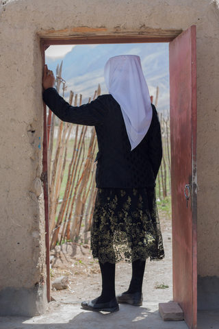 Pamiri Tajik Women standing at the Door